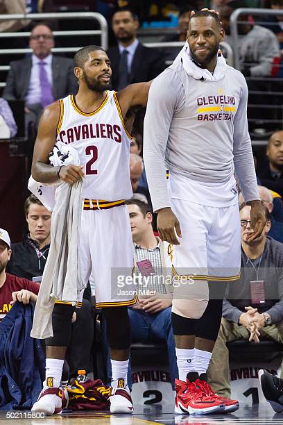 Kyrie Irving and LeBron James of the Cleveland Cavaliers celebrate on the sidelines during the second half against the Philadelphia 76ers at Quicken...