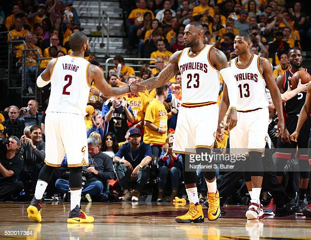 Kyrie Irving and LeBron James of the Cleveland Cavaliers celebrate against the Toronto Raptors in Game One of the Eastern Conference Finals during...