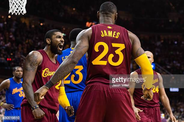 Kyrie Irving and LeBron James of the Cleveland Cavaliers celebrate after James scored during the second half against the Golden State Warriors at...