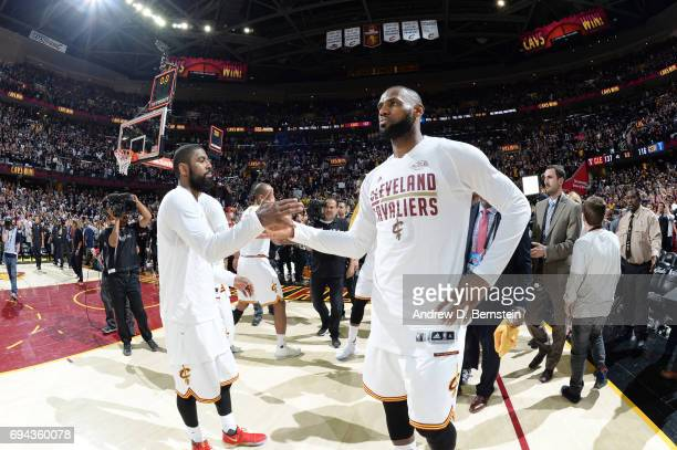 Kyrie Irving and LeBron James of the Cleveland Cavaliers celebrate after Game Four of the 2017 NBA Finals on June 9 2017 at Quicken Loans Arena in...