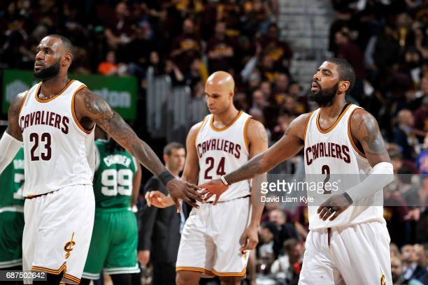 Kyrie Irving and LeBron James of the Cleveland Cavaliers high five each other during the game against the Boston Celtics in Game Four of the Eastern...