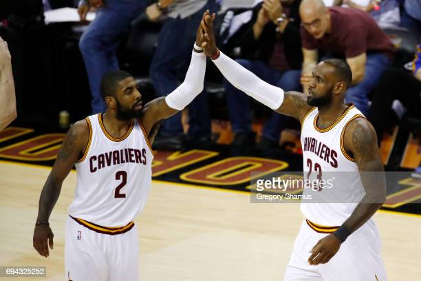 Kyrie Irving and LeBron James of the Cleveland Cavaliers high five against the Golden State Warriors in Game 4 of the 2017 NBA Finals at Quicken...