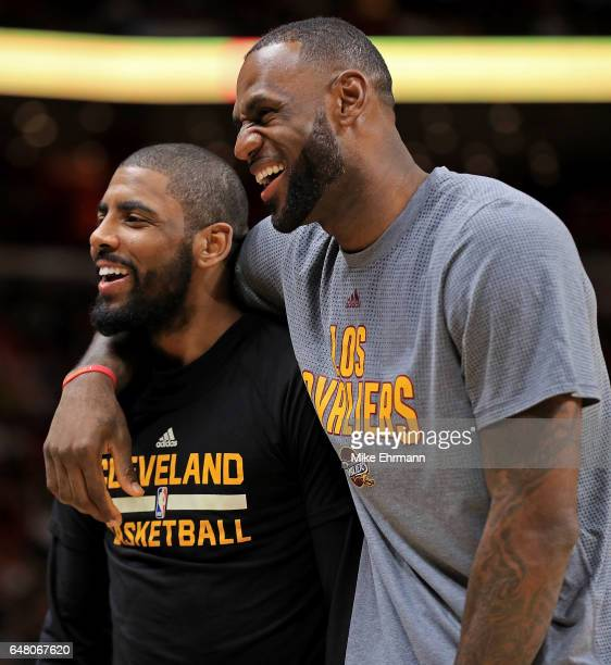 Kyrie Irving and LeBron James of the Cleveland Cavaliers laugh during a game against the Miami Heat at American Airlines Arena on March 4 2017 in...