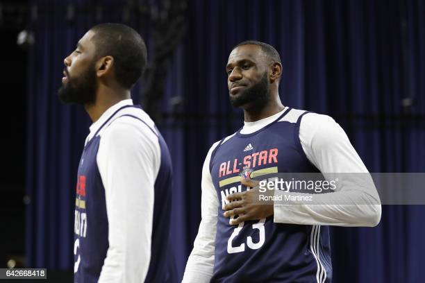 Kyrie Irving and LeBron James of the Cleveland Cavaliers look on during practice for the 2017 NBA AllStar Game at the MercedesBenz Superdome on...