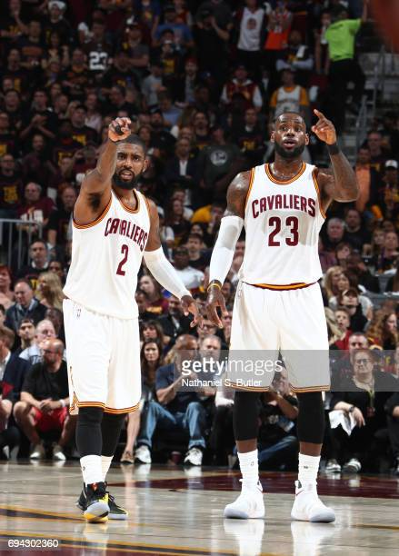 Kyrie Irving and LeBron James of the Cleveland Cavaliers looks on during the game against the Golden State Warriors in Game Three of the 2017 NBA...