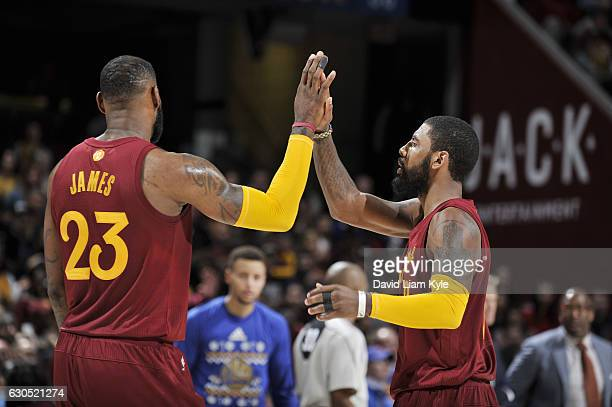 Kyrie Irving and LeBron James of the Cleveland Cavaliers shake hands during the game against the Golden State Warriors on December 25 2016 at Quicken...