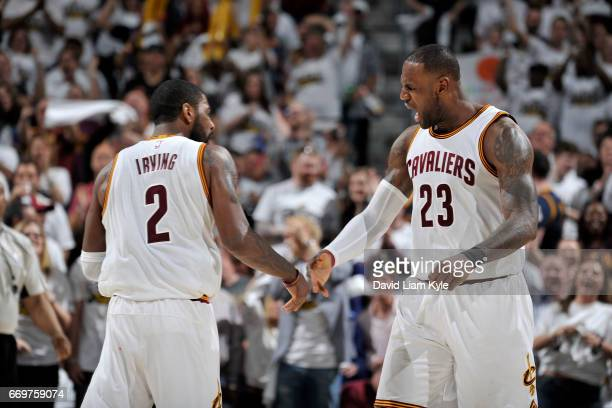 Kyrie Irving and LeBron James of the Cleveland Cavaliers shake hands against the Indiana Pacers in Round One of the Eastern Conference Playoffs...