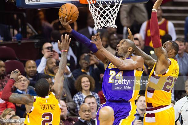 Kyrie Irving and LeBron James of the Cleveland Cavaliers try to stop Kobe Bryant of the Los Angeles Lakers during the second half at Quicken Loans...