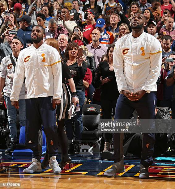 Kyrie Irving and LeBron James of the Cleveland Cavaliers watch the championship banner being raised before the game against the New York Knicks on...