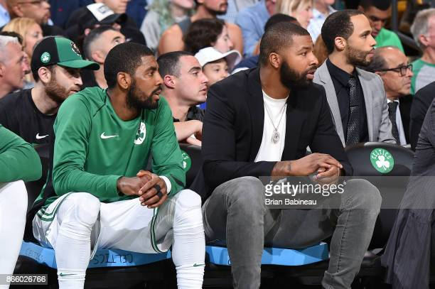 Kyrie Irving and Marcus Morris of the Boston Celtics looks on during the game against the New York Knicks on October 24 2017 at the TD Garden in...