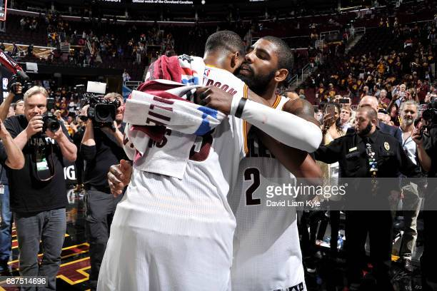Kyrie Irving and Tristan Thompson of the Cleveland Cavaliers share a hug after the game against the Boston Celtics in Game Four of the Eastern...