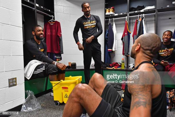 Kyrie Irving Dahantay Jones and JR Smith of the Cleveland Cavaliers get ready in the lockeroom before Game Five of the Eastern Conference Finals...