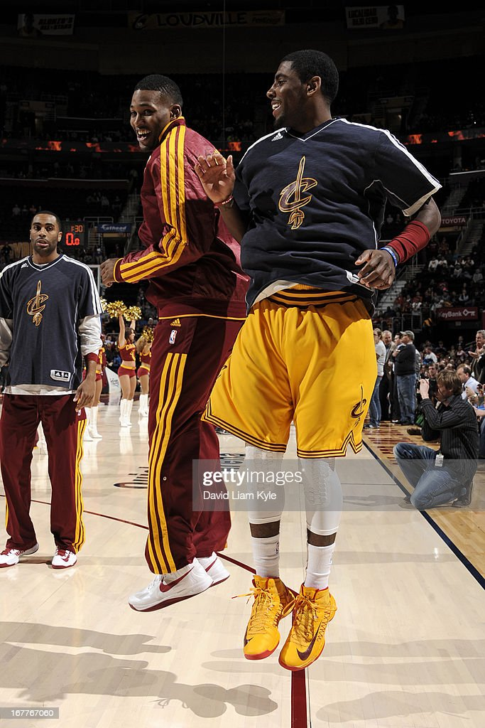<a gi-track='captionPersonalityLinkClicked' href=/galleries/search?phrase=Kyrie+Irving&family=editorial&specificpeople=6893971 ng-click='$event.stopPropagation()'>Kyrie Irving</a> #2 greets teammate <a gi-track='captionPersonalityLinkClicked' href=/galleries/search?phrase=Alonzo+Gee&family=editorial&specificpeople=801443 ng-click='$event.stopPropagation()'>Alonzo Gee</a> #33 of the Cleveland Cavaliers before the game against the Brooklyn Nets at The Quicken Loans Arena on April 3, 2013 in Cleveland, Ohio.
