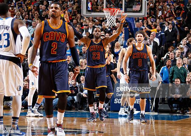 Kyrie Irving LeBron James and Kevin Love of the Cleveland Cavaliers celebrate a win against the Dallas Mavericks on January 12 2016 at the American...