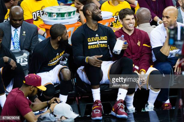 Kyrie Irving LeBron James and Kyle Korver of the Cleveland Cavaliers joke on the bench during the second half of Game One of the NBA Eastern...