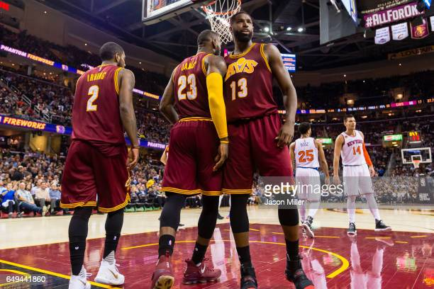 Kyrie Irving LeBron James and Tristan Thompson of the Cleveland Cavaliers celebrate after a play during the first half against the New York Knicks at...