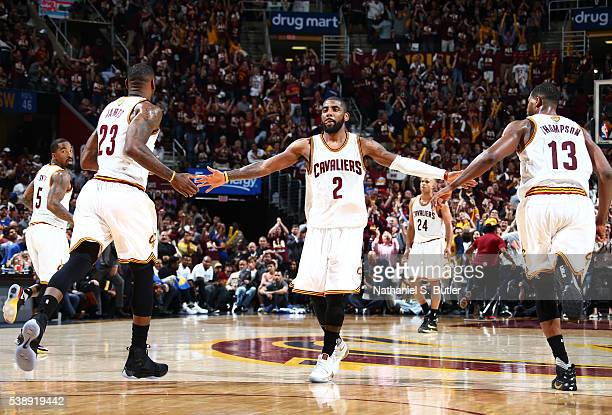 Kyrie Irving LeBron James and Tristan Thompson of the Cleveland Cavaliers high five each other during the game during Game Three of the 2016 NBA...