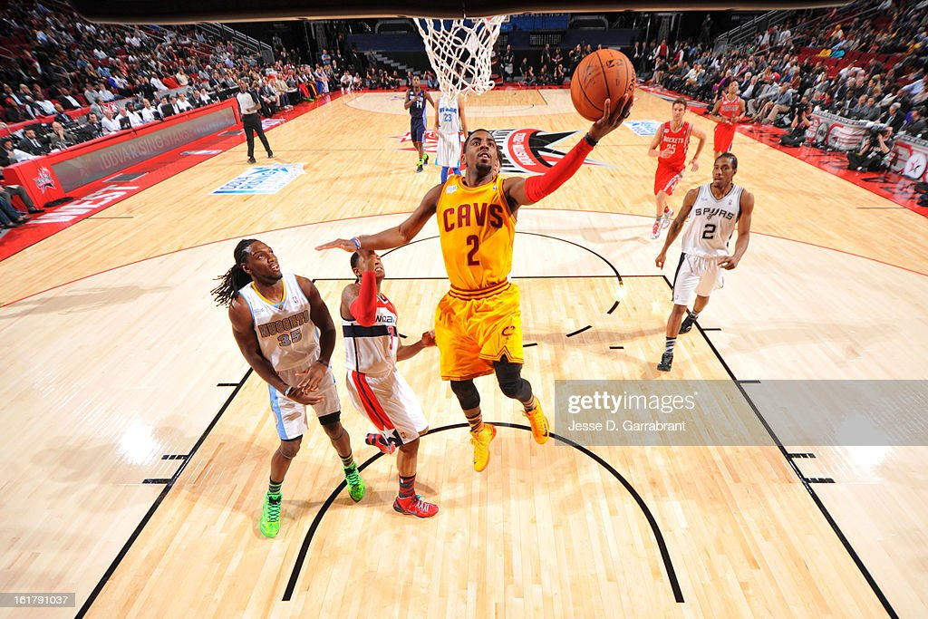 <a gi-track='captionPersonalityLinkClicked' href=/galleries/search?phrase=Kyrie+Irving&family=editorial&specificpeople=6893971 ng-click='$event.stopPropagation()'>Kyrie Irving</a> #2 of Team Shaq goes to the basket against Team Chuck during the 2013 BBVA Rising Stars Challenge at Toyota Center on February 15, 2013 in Houston, Texas.