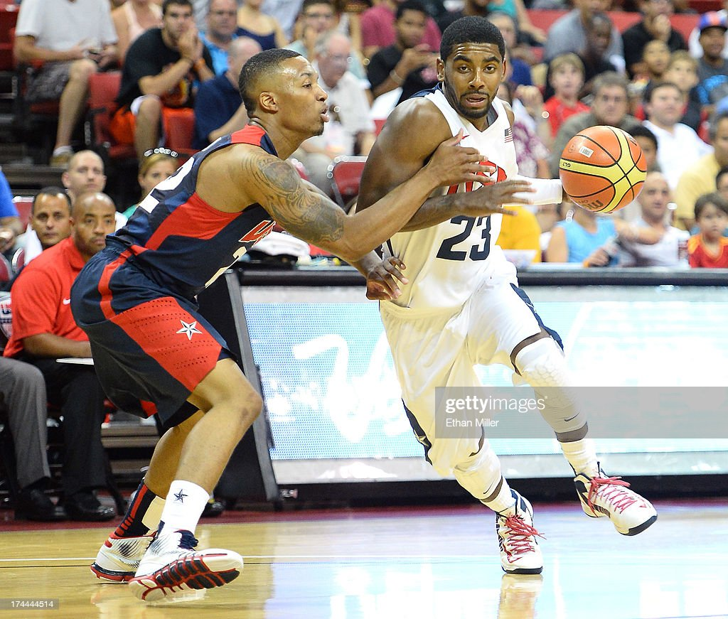 <a gi-track='captionPersonalityLinkClicked' href=/galleries/search?phrase=Kyrie+Irving&family=editorial&specificpeople=6893971 ng-click='$event.stopPropagation()'>Kyrie Irving</a> #23 of the 2013 USA Basketball Men's National Team drives against <a gi-track='captionPersonalityLinkClicked' href=/galleries/search?phrase=Damian+Lillard&family=editorial&specificpeople=6598327 ng-click='$event.stopPropagation()'>Damian Lillard</a> #22 of the 2013 USA Basketball Men's National Team during a USA Basketball showcase at the Thomas & Mack Center on July 25, 2013 in Las Vegas, Nevada.