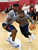 Kyrie Irving of the 2016 USA Basketball Men's National Team drives against Jimmy Butler of the 2016 USA Basketball Men's National Team during a...