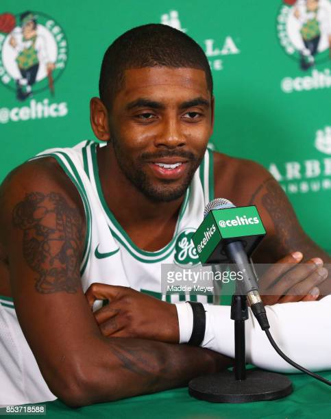 Kyrie Irving of the Boston Celtics answers questions from reporters during Boston Celtics Media Day at High Output Studios on September 25 2017 in...