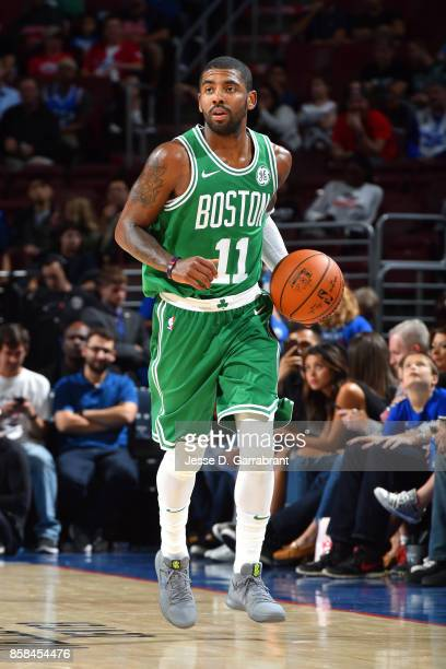 Kyrie Irving of the Boston Celtics brings the ball up court during the game against the Philadelphia 76ers during a preseason on October 6 2017 at...