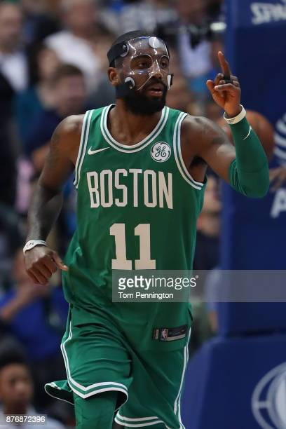 Kyrie Irving of the Boston Celtics celebrates after scoring against the Dallas Mavericks in the first half at American Airlines Center on November 20...