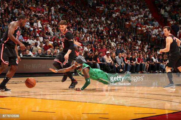 Kyrie Irving of the Boston Celtics dives for the ball during game against the Miami Heat on November 22 2017 at AmericanAirlines Arena in Miami...