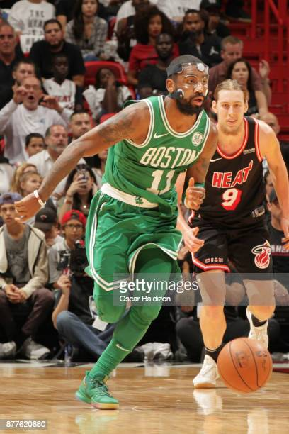 Kyrie Irving of the Boston Celtics drives the ball down court against the Miami Heat on November 22 2017 at American Airlines Arena in Miami Florida...