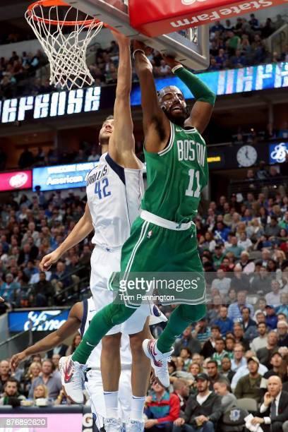 Kyrie Irving of the Boston Celtics drives to the basket against Dirk Nowitzki of the Dallas Mavericks at American Airlines Center on November 20 2017...