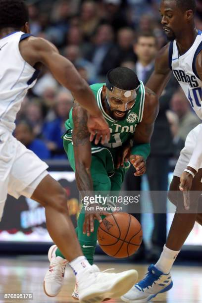 Kyrie Irving of the Boston Celtics drives to the basket against Harrison Barnes of the Dallas Mavericks at American Airlines Center on November 20...