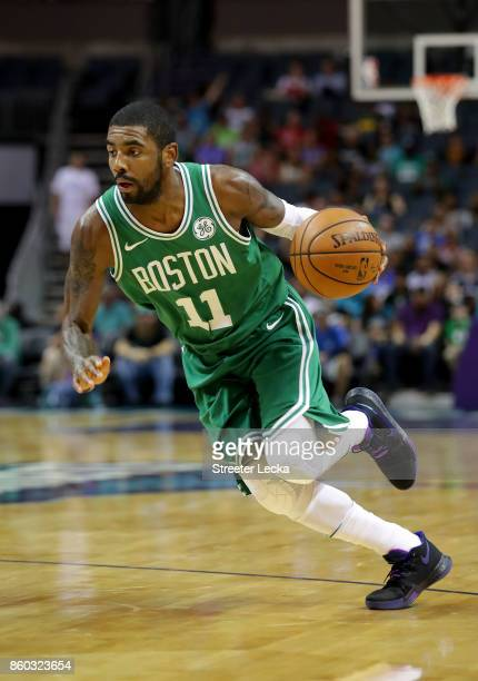 Kyrie Irving of the Boston Celtics drives to the basket againt the Charlotte Hornets during their game at Spectrum Center on October 11 2017 in...