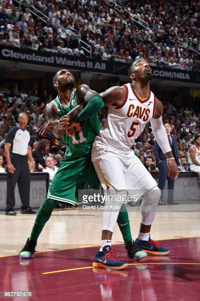 Kyrie Irving of the Boston Celtics fights for position against JR Smith of the Cleveland Cavaliers on October 17 2017 at Quicken Loans Arena in...