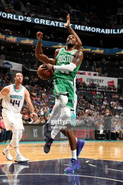Kyrie Irving of the Boston Celtics goes to the basket against the Charlotte Hornets on October 11 2017 at Spectrum Center in Charlotte North Carolina...