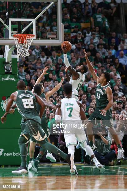 Kyrie Irving of the Boston Celtics goes to the basket against the Milwaukee Bucks on October 18 2017 at the TD Garden in Boston Massachusetts NOTE TO...