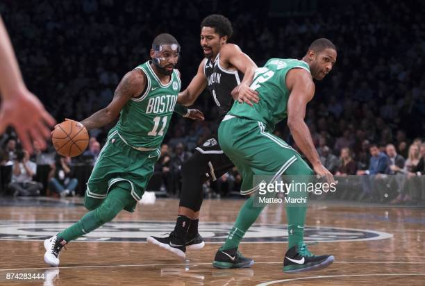 Kyrie Irving of the Boston Celtics handles the ball against Spencer Dinwiddie of the Brooklyn Nets during the first half of the NBA game at Barclays...