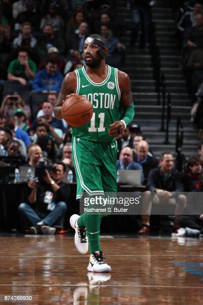 Kyrie Irving of the Boston Celtics handles the ball against the Brooklyn Nets on November 14 2017 at Barclays Center in Brooklyn New York NOTE TO...