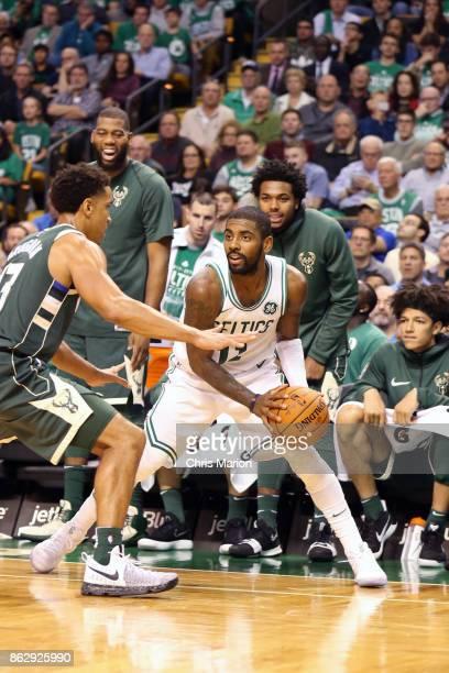 Kyrie Irving of the Boston Celtics handles the ball against the Milwaukee Bucks on October 18 2017 at the TD Garden in Boston Massachusetts NOTE TO...