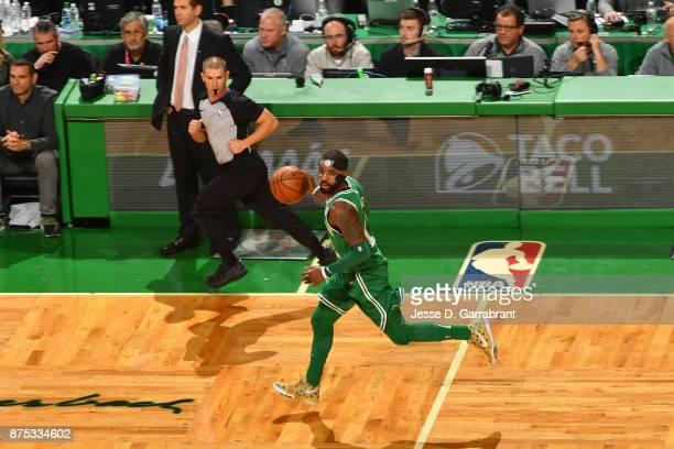 Kyrie Irving of the Boston Celtics handles the ball against the Golden State Warriors on November 16 2017 at the TD Garden in Boston Massachusetts...