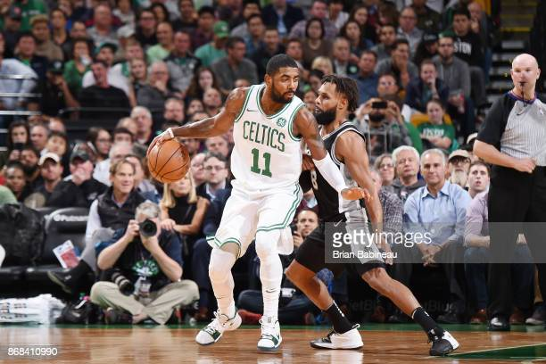 Kyrie Irving of the Boston Celtics handles the ball against the San Antonio Spurs on October 30 2017 at the TD Garden in Boston Massachusetts NOTE TO...