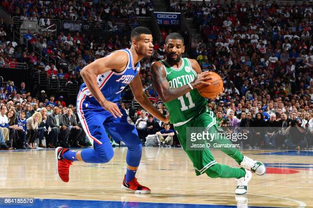 Kyrie Irving of the Boston Celtics handles the ball against Timothe LuwawuCabarrot of the Philadelphia 76ers during the game on October 20 2017 at...