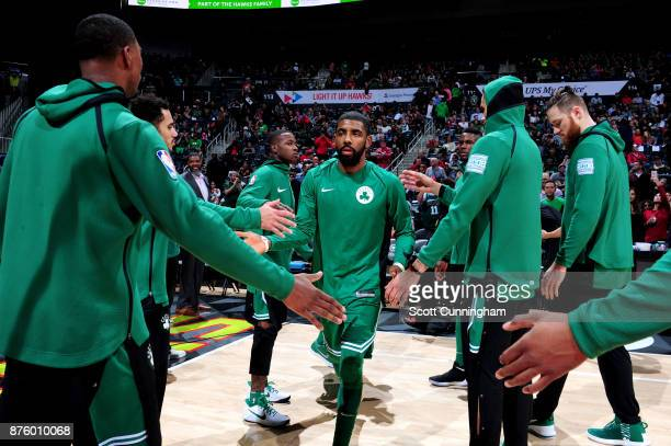 Kyrie Irving of the Boston Celtics high fives his teammates before the game against the Atlanta Hawks on November 18 2017 at Philips Arena in Atlanta...