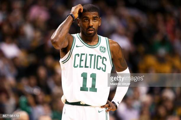 Kyrie Irving of the Boston Celtics looks on during the first half against the Charlotte Hornets at TD Garden on October 2 2017 in Boston...