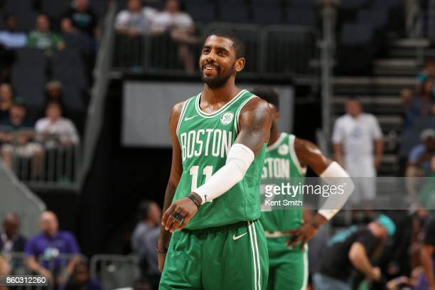 Kyrie Irving of the Boston Celtics looks on during the game against the Charlotte Hornets on October 11 2017 at Spectrum Center in Charlotte North...