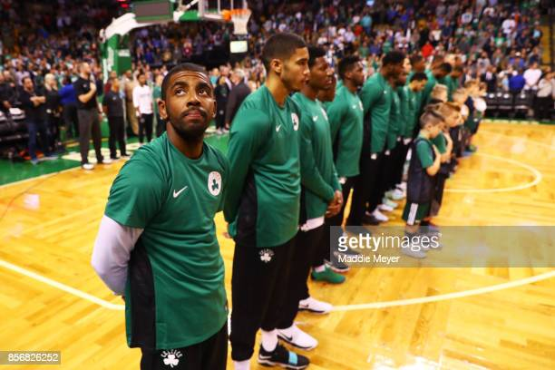 Kyrie Irving of the Boston Celtics looks on during the national anthem before the game against the Charlotte Hornets at TD Garden on October 2 2017...