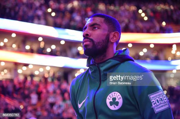 Kyrie Irving of the Boston Celtics looks on during the National Anthem before the game against the San Antonio Spurs on October 30 2017 at the TD...