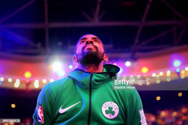 Kyrie Irving of the Boston Celtics looks on during the singing of the national anthem before the game against the New York Knicks at TD Garden on...