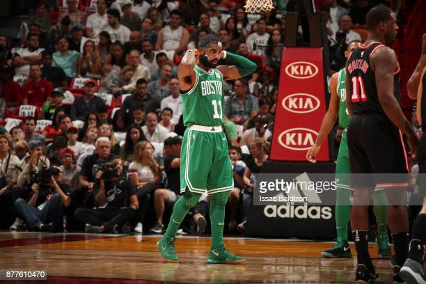 Kyrie Irving of the Boston Celtics puts on mask during game against the Miami Heat on November 22 2017 at AmericanAirlines Arena in Miami Florida...