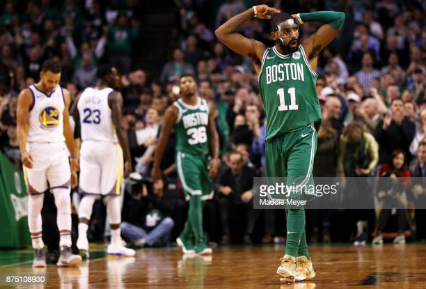 Kyrie Irving of the Boston Celtics rallies the crowd during the second quarter against the Golden State Warriors at TD Garden on November 16 2017 in...