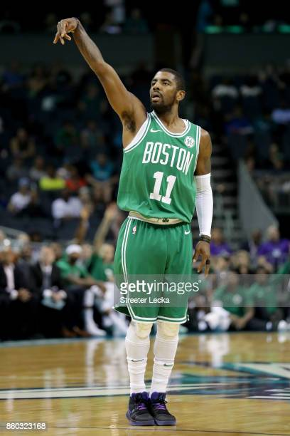 Kyrie Irving of the Boston Celtics reacts after a shot against the Charlotte Hornets during their game at Spectrum Center on October 11 2017 in...